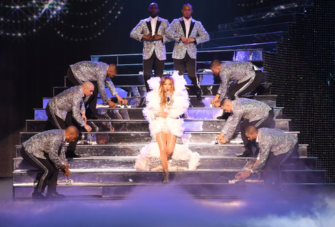 Jennifer Lopez walking down stairs on stage