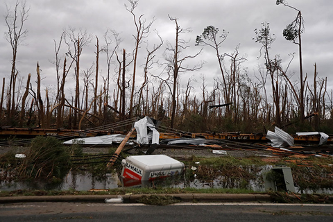 Shredded trees, derailed train cars and a sunken trailer are seen in the aftermath of Hurricane Michael in Panama City, FL.