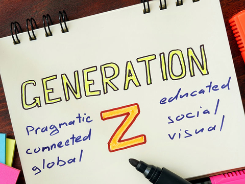 Notepad with generation z on the wooden table.