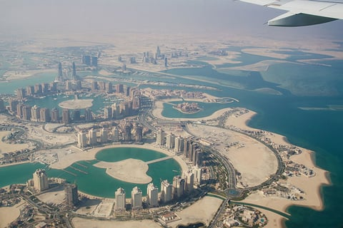 Airplane flying over Doha Qatar