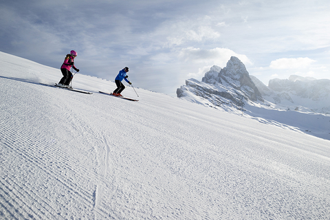 pair skiing in the Dolomites