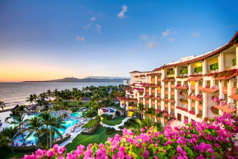 An exterior view of Grand Velas Riviera Nayarit with the water next to it