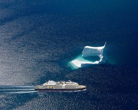 Image of he new yacht sailing next to a glacier