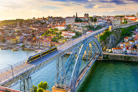 train crosses the Dom Luis I Bridge over the Douro River in Porto, Portugal