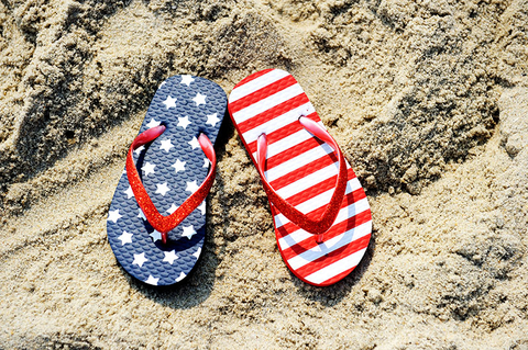 American flag sandals on a beach