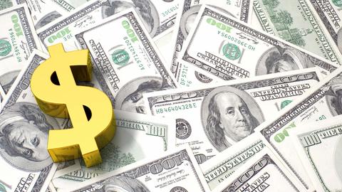 Brass USD money sign on pile of cash