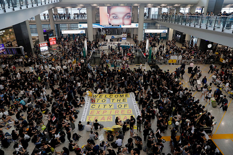Thousands take part in a sit-in protest at the airport in Hong Kong.