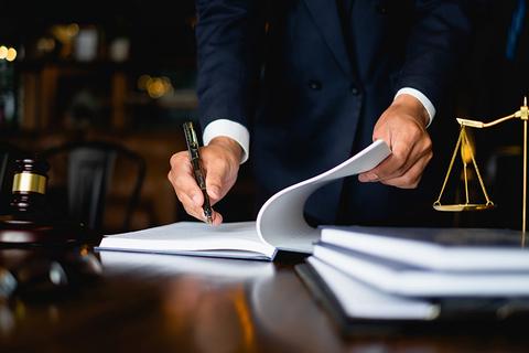 Man signing law