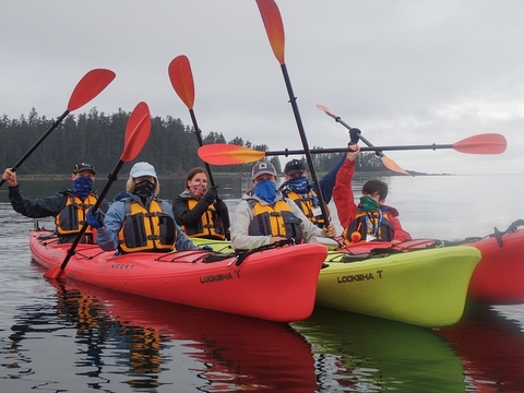 Guests on Wilderness Adventure head out kayaking during UnCruise Adventures Alaska sailin
