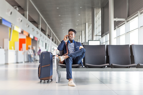 man at airport with luggage