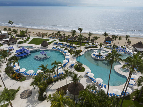 Mexico development with pools, the ocean and palm trees