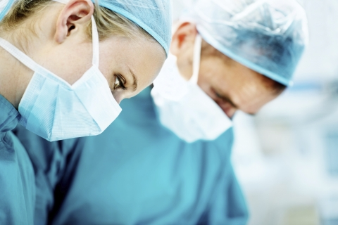 Two doctors conducting surgery