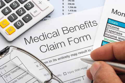 Person filling out a medical claim form