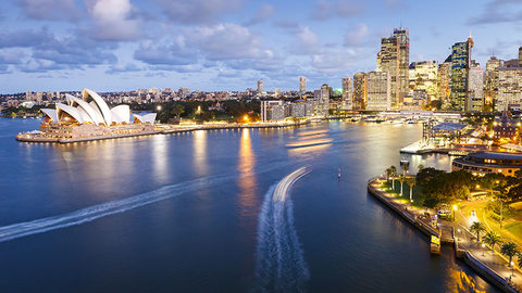 Circular Quay Sydney taken from the Sydney Harbour Bridge just after sunset showing the Sydney Opera House on the left.