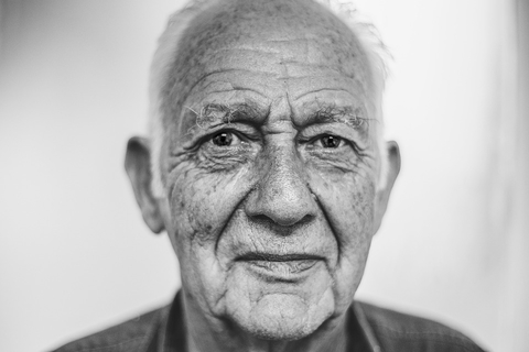 an old man without a smile