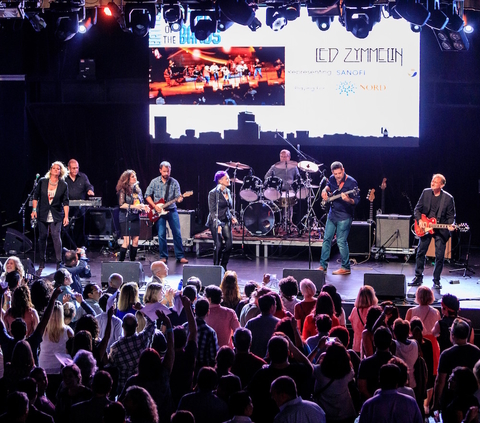 Sanofi Genzyme band Led Zymmelin performing on stage