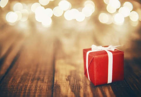 Humbug fewer companies are giving gifts in 2017 asi says fierceceo red present on wood background fewer companies will be giving gifts negle Choice Image