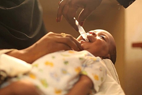 child receiving rotavirus vaccine