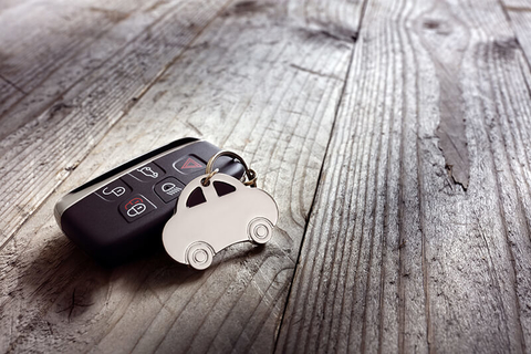 car keys on a wooden table