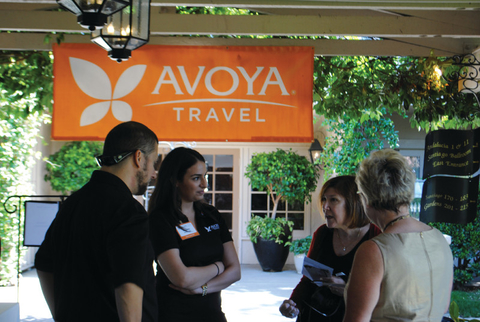 Attendees talking at Avoya Travel conference