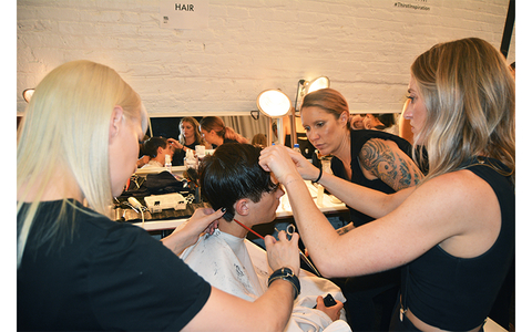Jaime (right) and team collaborate on a model's look