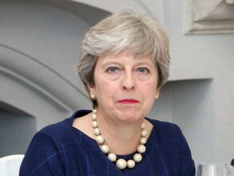 Theresa May: Use AI as 'weapon' against cancer