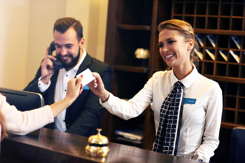 Smiling front-desk employees