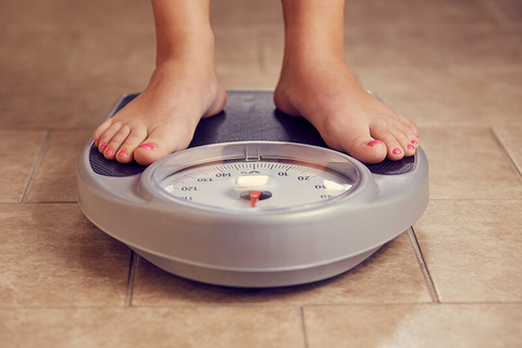 feet on scale weighing