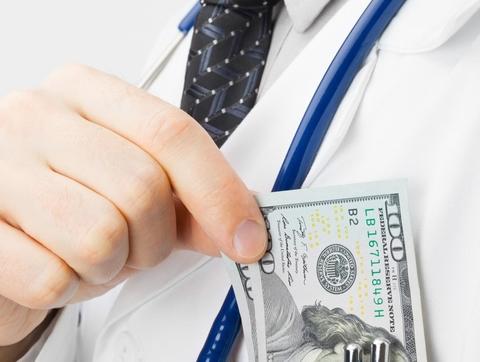 Doctor putting money in pocket