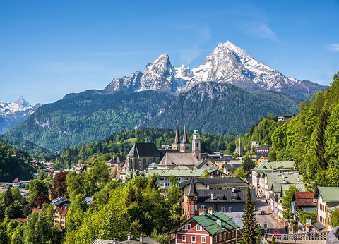The historic town of Berchtesgaden overlooked by the snowy Watzmann mountain in spring,  in Berchtesgadener Land, Upper Bavaria, Germany