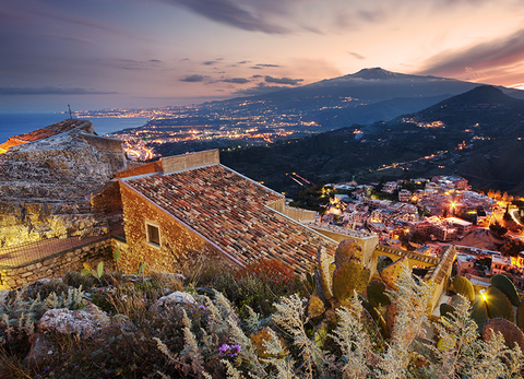 Taormina Sicily with a view of Mount Etna and the Ionian Sea