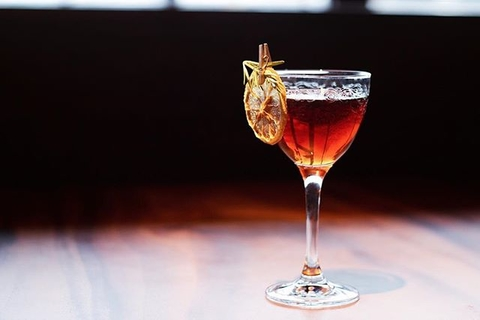 Cocktail with dehydrated orange garnish at El Five in Denver, Colorado - How to Curate Your Instagram Presence
