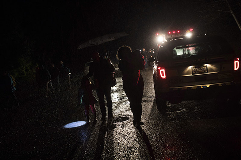 Tofino residents and visitors leave the community center after the tsunami warning ends in Tofino, British Columbia.