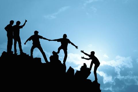 People using teamwork to climb