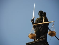 Justice statue with sword and scales
