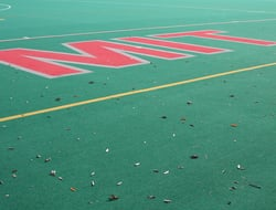 MIT written in the turf on a field