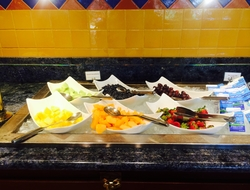 Bowls of fruit in a breakfast buffet