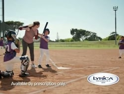 woman playing baseball with kids