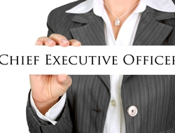 Woman in business suit holding a sign that says chief executive officer