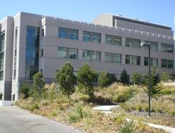 A large, tan building along a road