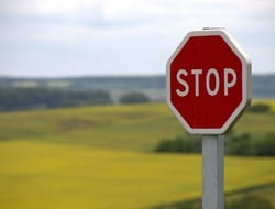 Stop sign with field in background