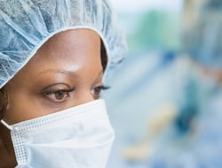 A surgeon focused on her work