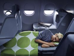 Finnair business woman sleeping