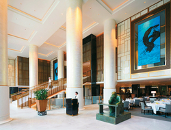 """The Lobby includes 16-foot abstract ink paintings, bronze sculptures of tea drinkers and a hand-carved jade """"Spirit Wall"""" just beyond the entrance archway."""