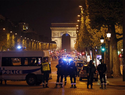 Police seal off the Champs Elysees avenue in Paris, France, after a fatal shooting in which a police officer was killed along with an attacker.