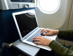 Laptop in use by a woman on plane