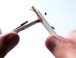 broken pencil in fingers
