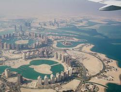 Airplane flying over Doha Qatar