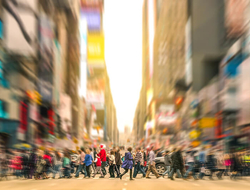 commuters walking across the street in New York City