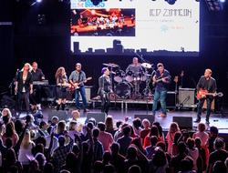 Sanofi Genzyme band Led Zymmelin performing on stage